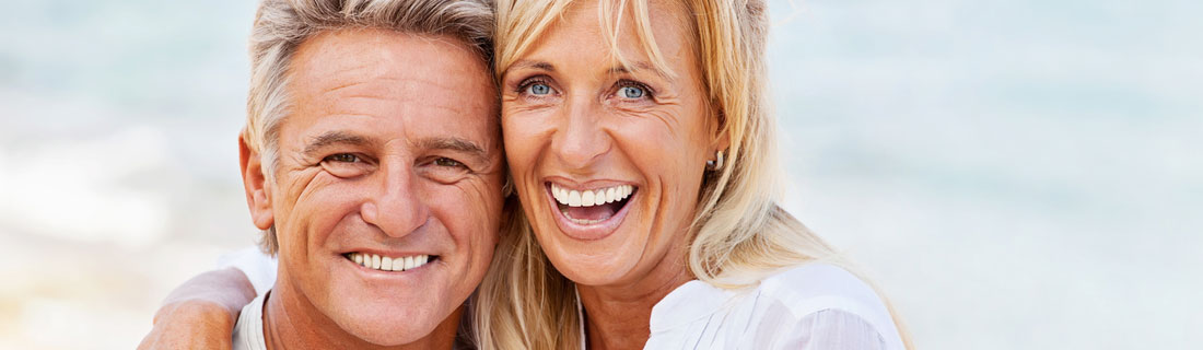 couple-older-at-beach-smiling.jpg
