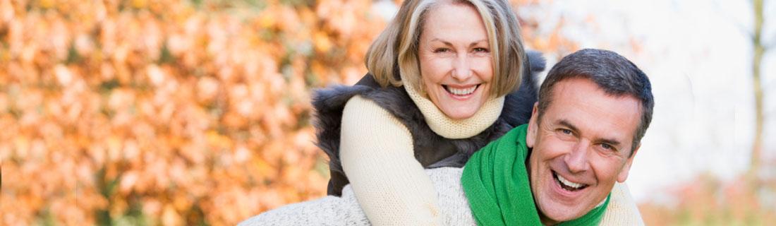 couple-older-smiling-outside-fall.jpg