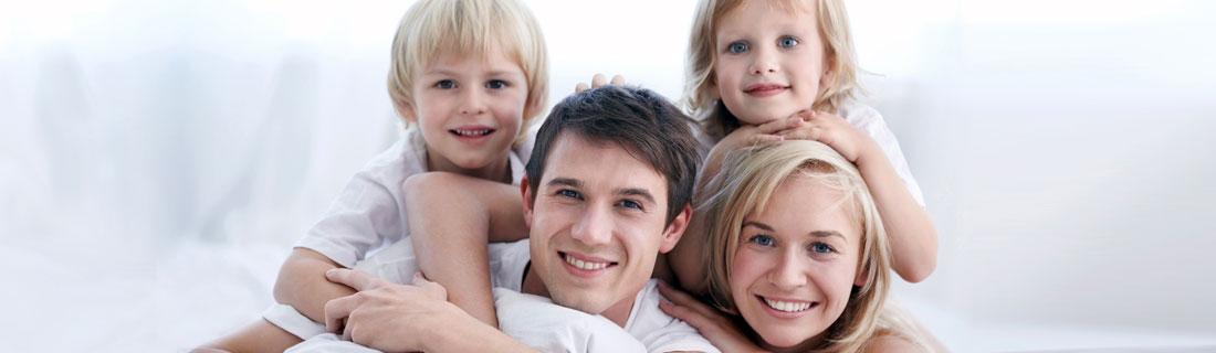 family-mom-dad-kids-smiling.jpg