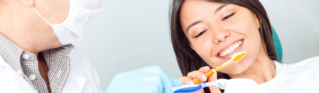 woman-at-dentist-brushing-teeth.jpg