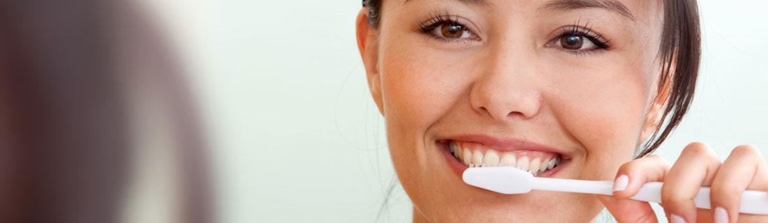 woman-brushing-her-teeth-smiling.jpg