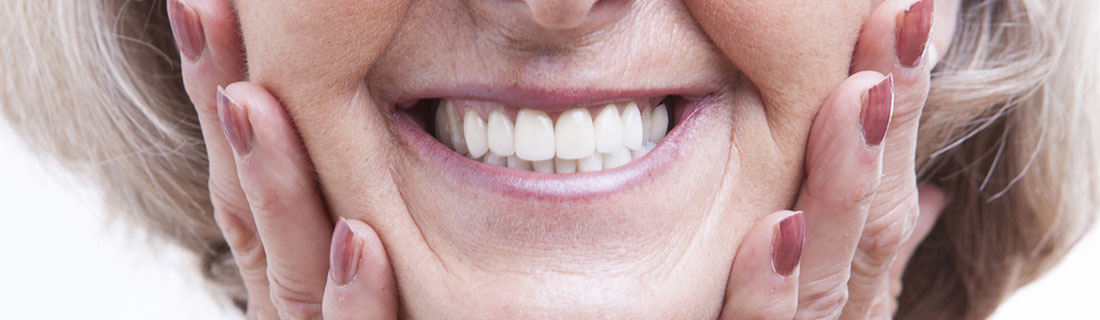 woman-older-dentures-smiling-closeup.jpg