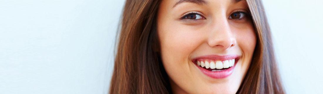 woman-pretty-smile-blue-background.jpg