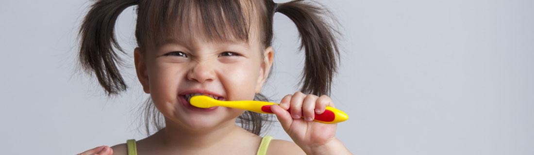 child-brushing-teeth-smiling-pigtails.jpg